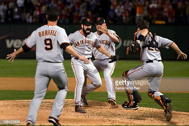 San Francisco Giants relief pitcher Brian Wilson celebrates with San Francisco Giants left fielder Pat Burrell San Francisco Giants first baseman...