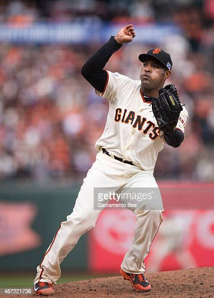 San Francisco Giants relief pitcher Santiago Casilla throws against the St Louis Cardinals in the ninth inning of Game 3 of the National League...