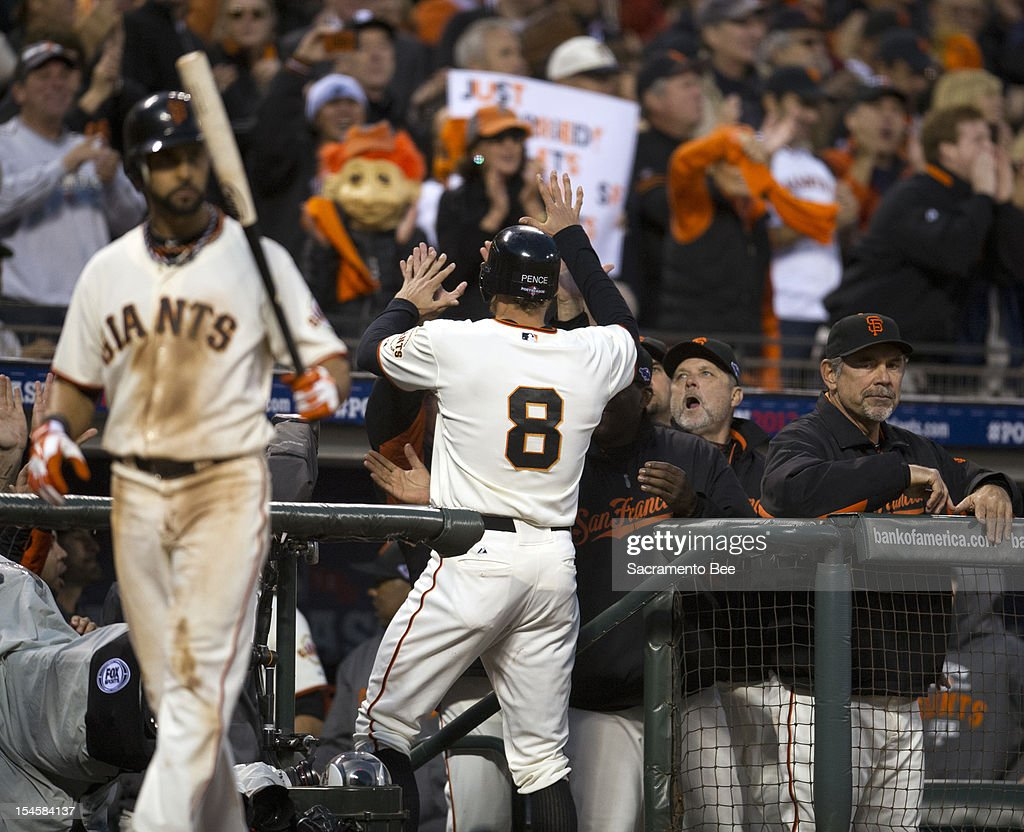 San Francisco Giants right fielder Hunter Pence (8) is greeted in the dugout after scoring in the third inning during Game 7 of the of the National League Championship Series at AT&T Park on Monday, October 22, 2012, in San Francisco, California.