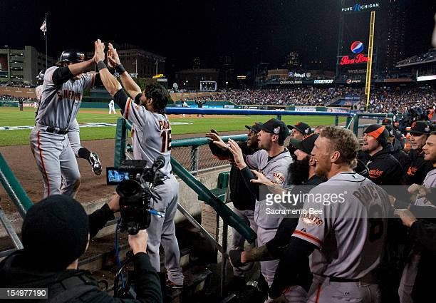 San Francisco Giants second baseman Ryan Theriot is greeted by teammates after he scores the winning run in the tenth inning on a RBI by San...
