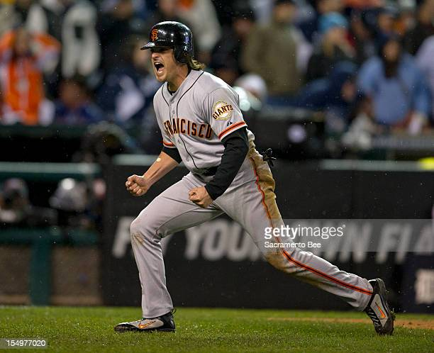 San Francisco Giants second baseman Ryan Theriot scores the winning run in the 10th inning as the San Francisco Giants beat the Detroit Tigers 43 in...