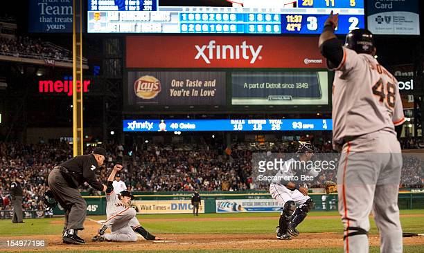 San Francisco Giants second baseman Ryan Theriot scores the winning run in the tenth inning as the San Francisco Giants beat the Detroit Tigers 43 in...