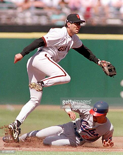 San Francisco Giants second baseman Steve Scarsone leaps over Chicago Cubs Luis Gonzalez while relaying to first base to complete a double play 12...