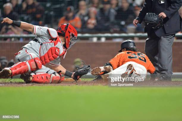 San Francisco Giants Shortstop Brandon Crawford slides into home plate during the San Francisco Giants versus Philadelphia Phillies game at ATT Park...