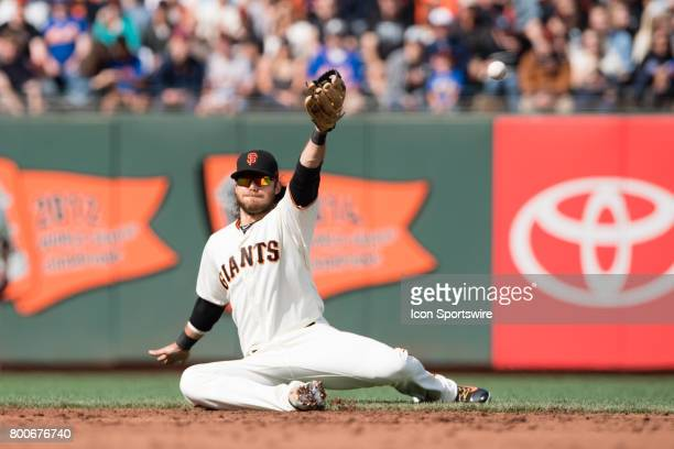 San Francisco Giants shortstop Brandon Crawford tries to field a ball during the game between the New York Mets and the San Francisco Giants on June...