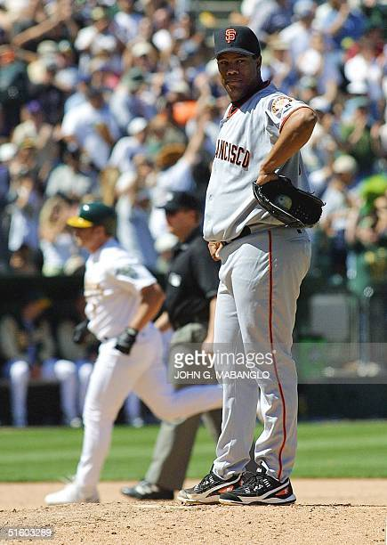 San Francisco Giants starting pitcher Livan Hernandez of Cuba looks away after giving up a homerun to Oakland Athletics Jeremy Giambi during the...