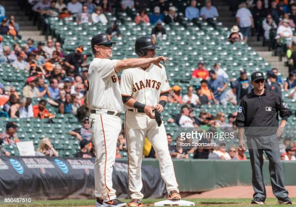San Francisco Giants Third Base Coach Phil Nevin discusses strategy with San Francisco Giants Second base Joe Panik during the regular season game...