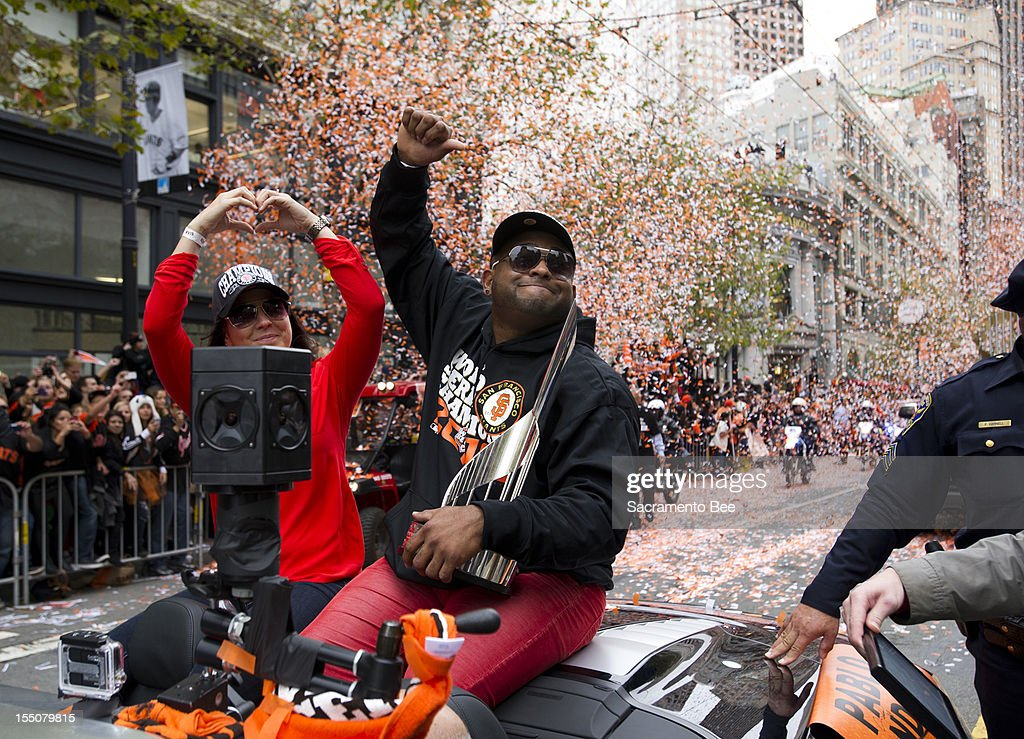 San Francisco Giants third baseman Pablo Sandoval waves to fans during a parade to celebrate the team's 2012 World Series Championship in downtown San Francisco, California, on Wednesday, October 31, 2012.