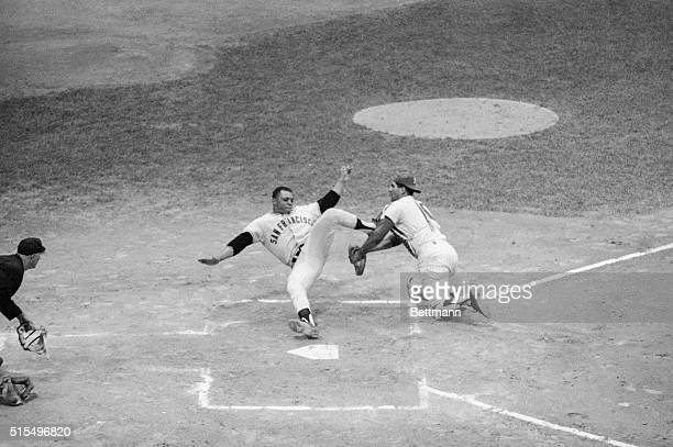 San Francisco Giant's Willie Mays collides with Phillies Pat Corrales at home plate here on a play in which Allen threw wild past 1st and Callison...