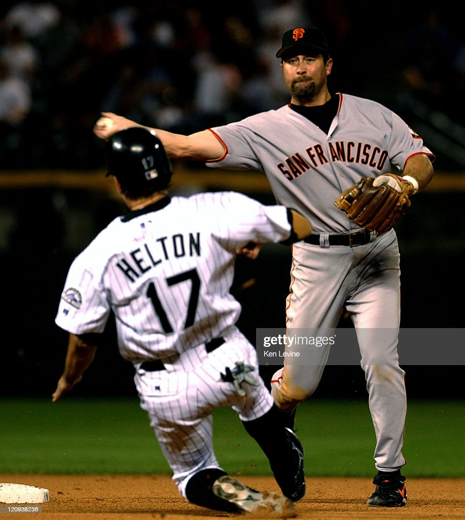 San Francisco Ginats shortstop <a gi-track='captionPersonalityLinkClicked' href=/galleries/search?phrase=Rich+Aurilia&family=editorial&specificpeople=209231 ng-click='$event.stopPropagation()'>Rich Aurilia</a> completes the double play by throwing to first to get the Colorado Rockies <a gi-track='captionPersonalityLinkClicked' href=/galleries/search?phrase=Preston+Wilson&family=editorial&specificpeople=213345 ng-click='$event.stopPropagation()'>Preston Wilson</a> as the Rockies <a gi-track='captionPersonalityLinkClicked' href=/galleries/search?phrase=Todd+Helton&family=editorial&specificpeople=200735 ng-click='$event.stopPropagation()'>Todd Helton</a> slides into second base too late during the 7th inning Wednesday Aug. 27, 2003 at Coors Field in Denver.