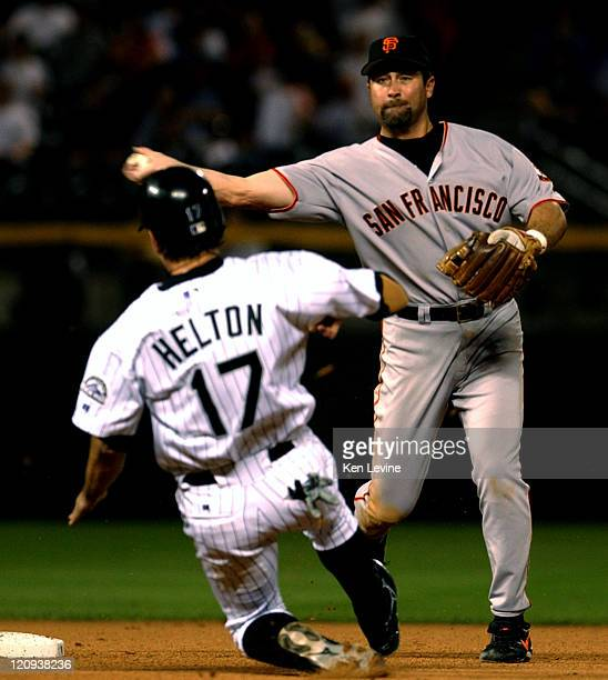 San Francisco Ginats shortstop Rich Aurilia completes the double play by throwing to first to get the Colorado Rockies Preston Wilson as the Rockies...