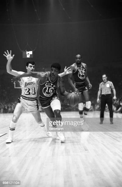 San Francisco guard Al Attles goes right past Los Angeles guard Johnny Egan to score in the first quarter at the Forum Also shown is San Francisco...