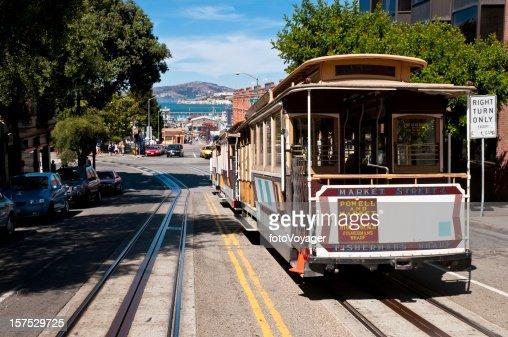 San Francisco historic cable car overlooking bay pier Alcatraz Island