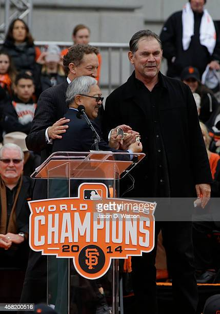 San Francisco Mayor Ed Lee hands a key to the city to owner Larry Baer and manager Bruce Bochy during the San Francisco Giants World Series victory...