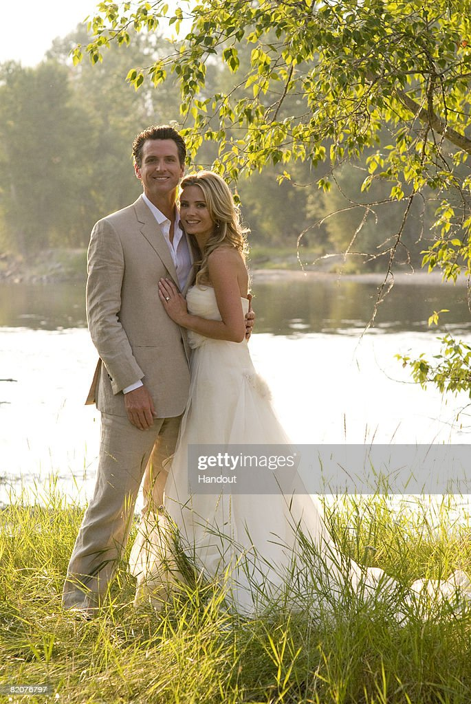 San Francisco Mayor Gavin Newsom poses with his new wife actress Jennifer Siebel July 26, 2008 in Stevensville, Montana. Newsom and Siebel were married at her parents' Montana ranch. The actress has a recurring role on the TV series 'Life.'