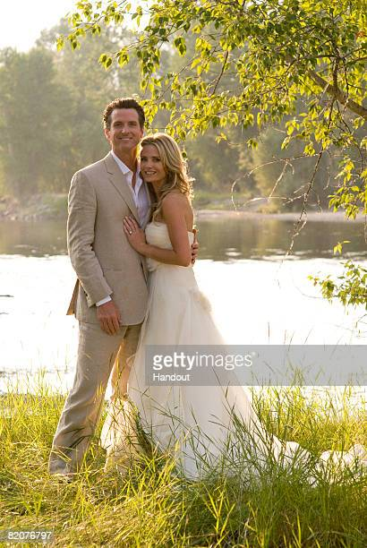 San Francisco Mayor Gavin Newsom poses with his new wife actress Jennifer Siebel July 26 2008 in Stevensville Montana Newsom and Siebel were married...