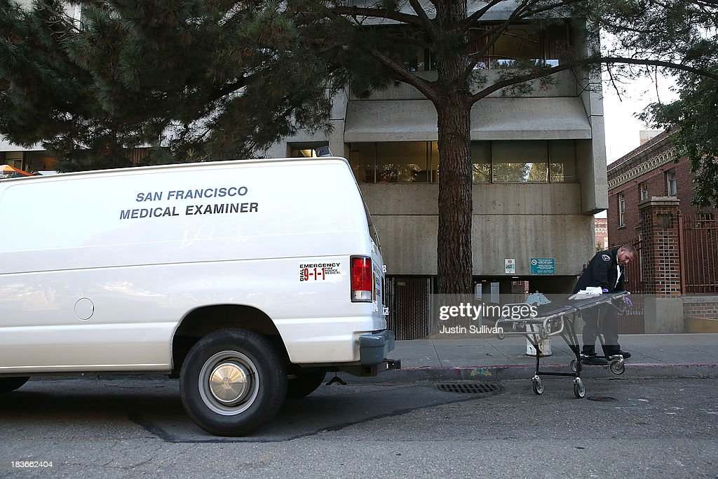A San Francisco medical examiner attendant removes a gurney from a van at San Francisco General Hospital on October 8, 2013 in San Francisco, California. 57-year-old Lynne Spalding, of San Francisco was believed to have been found dead this morning in a remote stairwell at San Francisco General Hospital after she was reported missing from her hospital room more than two weeks ago. Spalding was last seen on September 21 by hospital employees after she was undergoing treatment for an infection.