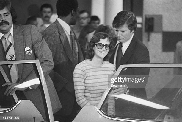 Newspaper Heiress Patricia Hearst captured by the FBI 9/18 along with SLA fugitives William and Emily Harris smiles as she leaves San Mateo County...