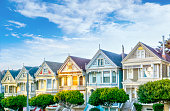 Late afternoon sun light up a row of colorful Victorian houses known as Painted Ladies across from Alamo Square. Built between 1892 and 1896, these houses are among the most iconic symbols of San Fran
