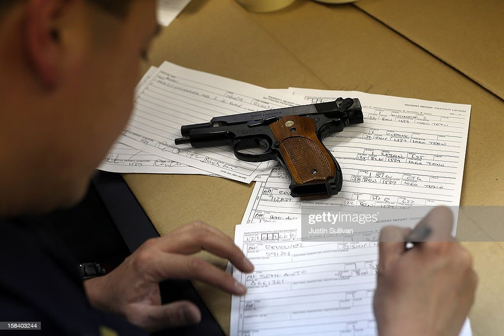 A San Francisco police officer documents a gun that is being surrendered during a gun buy back program on December 15, 2012 in San Francisco, California. The San Francisco police department held a one-day gun buy back event that paid $200 per gun turned in. A better than expected crowd resulted in payback money running out and vouchers were issued to collect money within a week. Over 200 guns were collected.