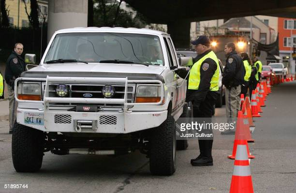 San Francisco police officers check drivers at a sobriety checkpoint December 26 2004 in San Francisco California The California Highway Patrol...