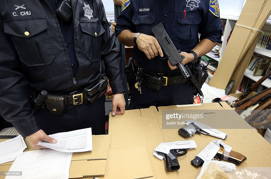 San Francisco police officers document guns that are being surrendered during a gun buy back program on December 15, 2012 in San Francisco, California. The San Francisco police department held a one-day gun buy back event that paid $200 per gun turned in. A better than expected crowd resulted in payback money running out and vouchers were issued to collect money within a week. Over 200 guns were collected.