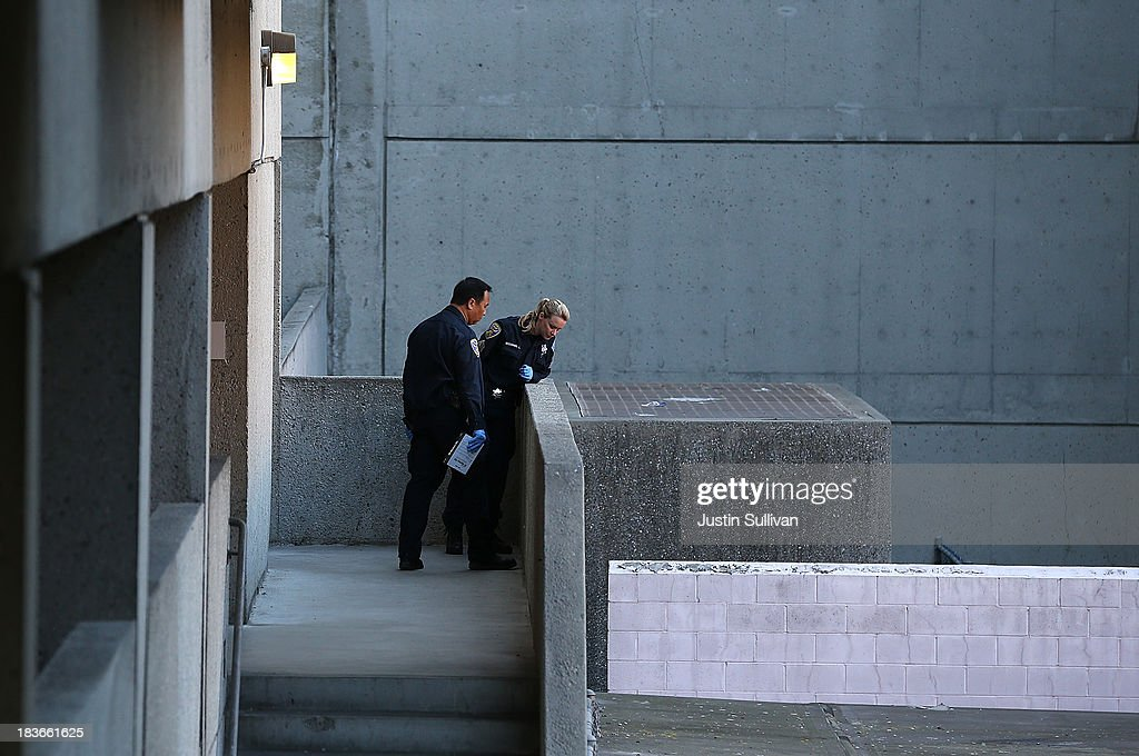 San Francisco police officers inspect an outdoor stairwell at San Francisco General Hospital on October 8, 2013 in San Francisco, California. 57-year-old Lynne Spalding, of San Francisco was believed to have been found dead this morning in a remote stairwell at San Francisco General Hospital after she was reported missing from her hospital room more than two weeks ago. Spalding was last seen on September 21 by hospital employees after she was undergoing treatment for an infection.
