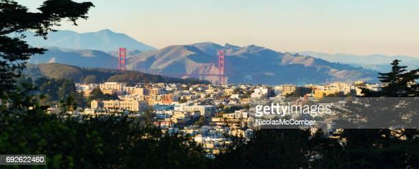 San Francisco Presidio Heights panorama at sunset with Golden Gate bridge