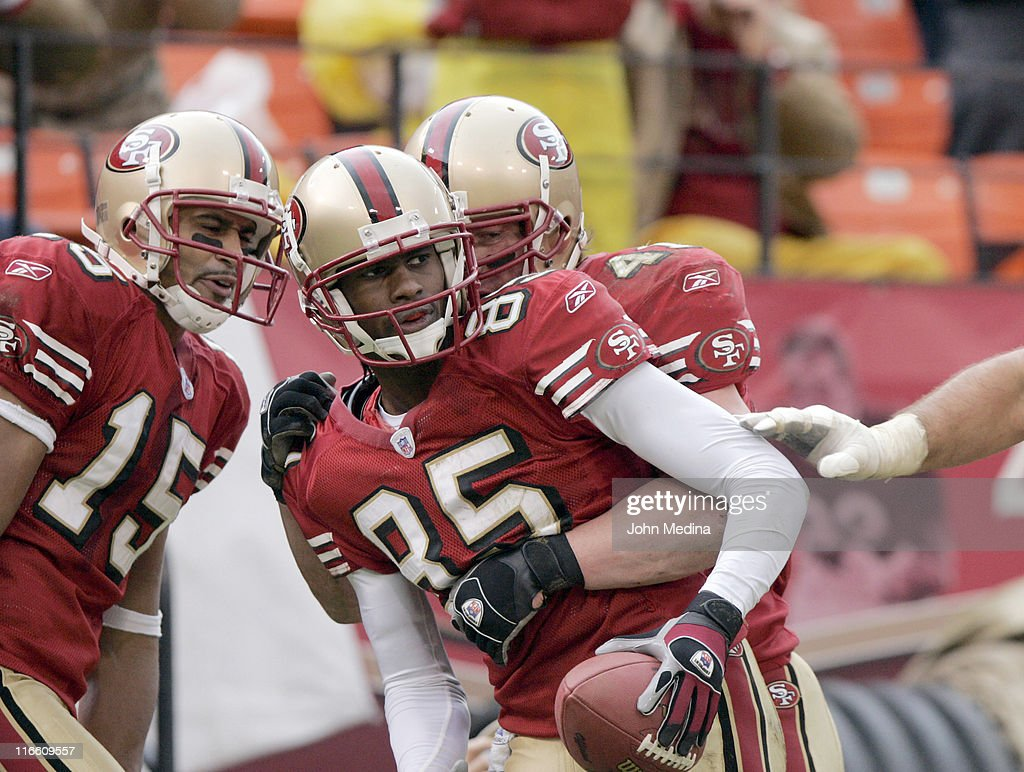 San Francisco receiver <a gi-track='captionPersonalityLinkClicked' href=/galleries/search?phrase=Brandon+Lloyd&family=editorial&specificpeople=206502 ng-click='$event.stopPropagation()'>Brandon Lloyd</a> is congratulated by teammates after catching a touchdown pass during the 49ers 20-17 overtime defeat of the Houston Texans January 1, 2006 at Monster Park in San Francisco, California.