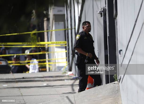 San Francisco sheriff deputy stands guard at the scene of a shooting at a UPS facility on June 14 2017 in San Francisco California A gunman opened...