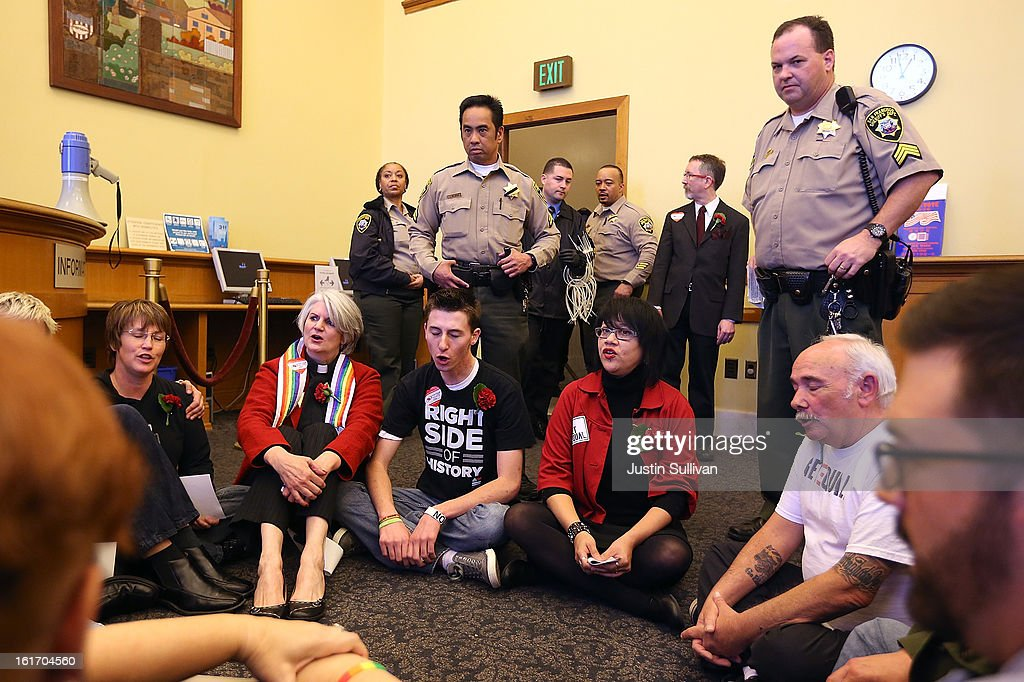 San Francisco sheriffs deputies prepare to arrest same-sex marriage advocates for staging a sit-in protest after same-sex couples were denied marriage licenses from the San Francisco county clerk on February 14, 2013 in San Francisco, California. Close to a dozen same-sex couples who were denied marriage licenses were arrested after they staged a sit-in demonstration inside the office of San Francisco's county clerk.