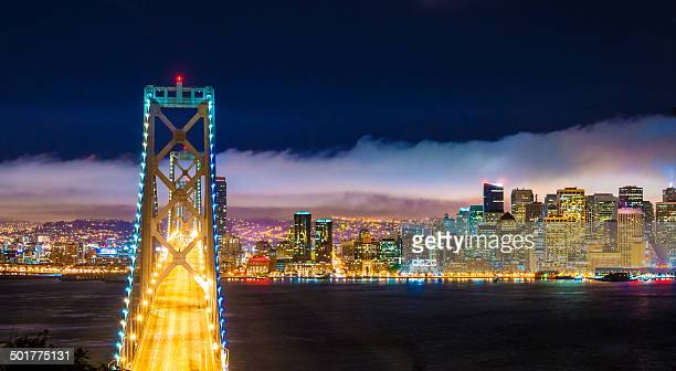 San Francisco skyline panorama and Oakland Bay Bridge at night