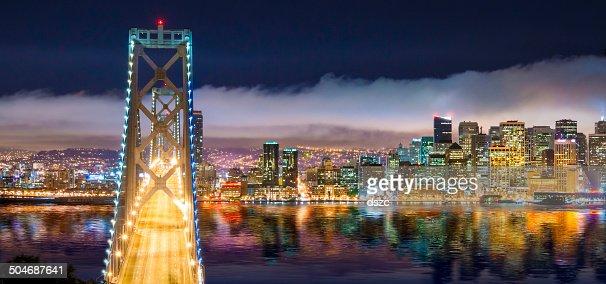 San Francisco skyline panorama and Oakland Bay Bridge at night