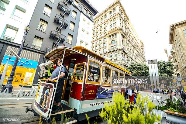 San Francisco street and famous cable car with tourists