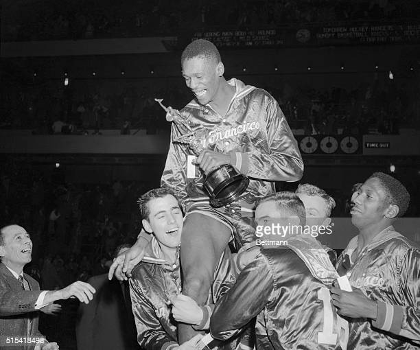 San Francisco teammates raise big Bill Russell on their shoulders in a spontaneous gesture of acclaim following tonight's triumph over the clans 7053...