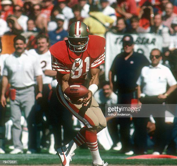 San Francisco tight end Russ Francis cradles the ball during a 2610 loss to the Chicago Bears on October 13 at Candlestick Park in San Francisco...