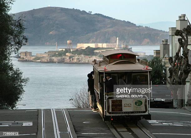 A cable car moves down to Fisherman's Wharf before Alcatraz Island in San Francisco 22 December 2007 The City and County of San Francisco is the...