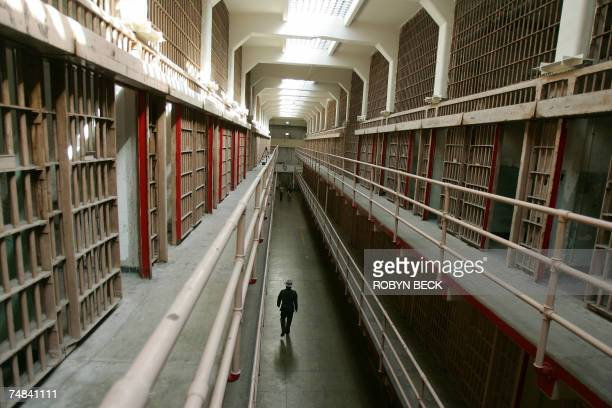 A National Park Service ranger walks down 'Broadway' in the main cell block on Alcatraz Island 14 June 2007 in San Francisco Bay of California...