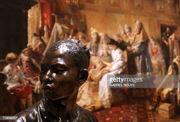 'Le Chinois' by French sculptor JeanBaptiste Carpeaux is displayed near 'The Russian Bride's Attire' by Russian painter Konstantin Makovsky at the...