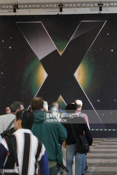 People wait in line for the keynote address by Apple Inc CEO Steve Jobs on the opening day of the Apple Worldwide Developers Conference 2007 at the...
