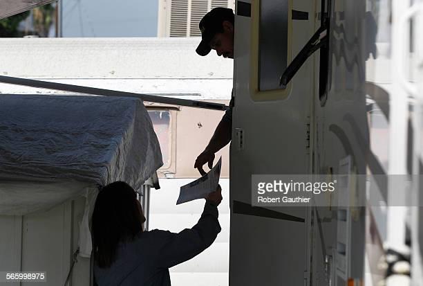 EL MONTE CA WEDNESDAY SEPTEMBER 14 2011 – San Gabriel Valley Mosquito Vector Control District Operations Coordinator Marta Tanaka hands a leaflet...
