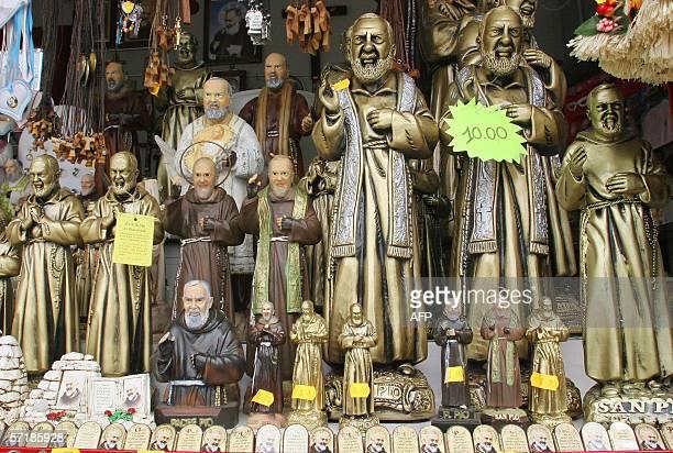 Picture taken 16 March 2006 of Padre Pio's statues in a souvenirs' shop in San Giovanni Rotondo AFP PHOTO / MARIO LAPORTA