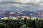 The skyline of San Jose, California jumps out as the sunshine hits it after a clearing storm.