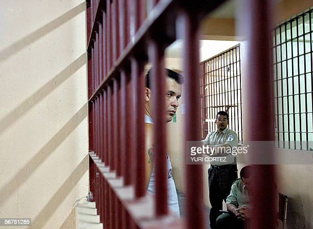 Alexander Barbosa a Costa Rican inmate waits under custody to vote at the Central prison known as 'San Sebastian' during presidential elections in...