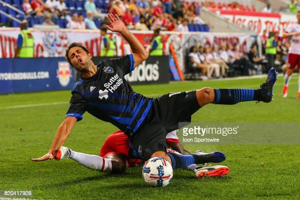 San Jose Earthquakes defender Andres Imperiale gets taken down by New York Red Bulls forward Bradley WrightPhillips during the Major League Soccer...