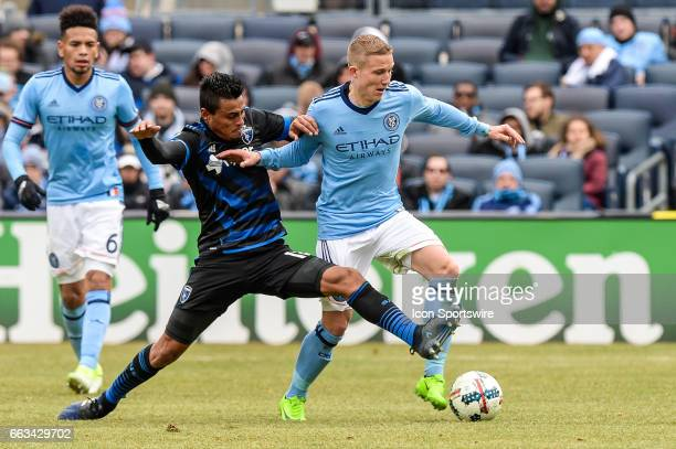 San Jose Earthquakes midfielder Darwin Ceren attempts to steal the ball from New York City FC midfielder Alexander Ring on April 01 at Yankee Stadium...