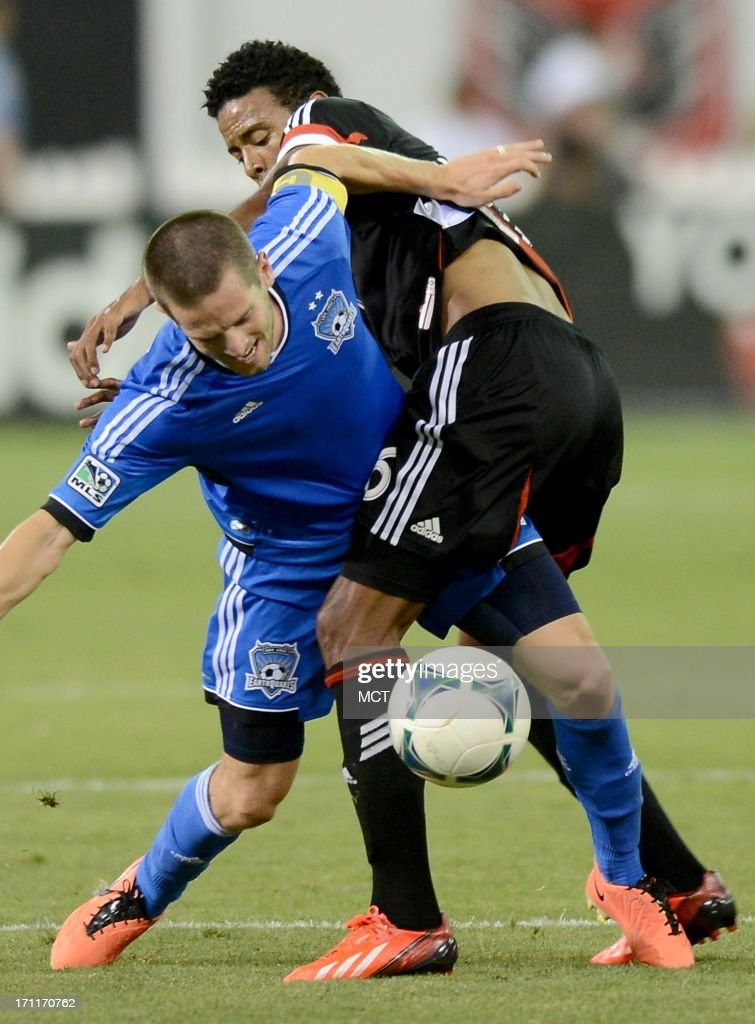 San Jose Earthquakes midfielder Sam Cronin (4) and D.C. United forward Lionard Pajoy (26) tangle during a battle for the ball late in the second half at RFK Stadium in Washington, D.C., Saturday, June 22, 2013. United defeated the Quakes, 1-0.