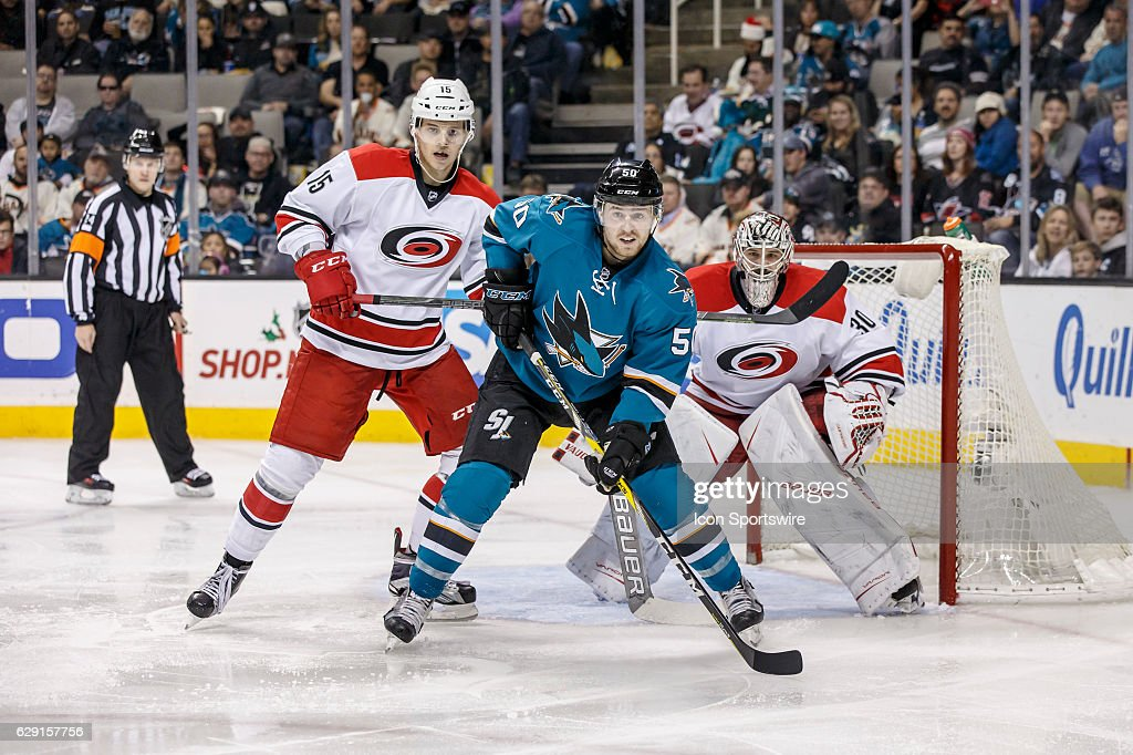 San Jose Sharks center Chris Tierney (50) in front of Carolina Hurricanes goalie Cam Ward (30) and center Andrej Nestrasil (15) during the second period of the regular season game between the Carolina Hurricanes and the San Jose Sharks held December 10, 2016 at the SAP Center in San Jose.Final score: Sharks- 4, Hurricanes- 3.