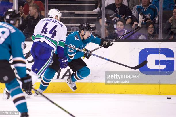San Jose Sharks center Logan Couture gets by Vancouver Canucks defenseman Erik Gudbranson during the NHL game between the San Jose Sharks and the...