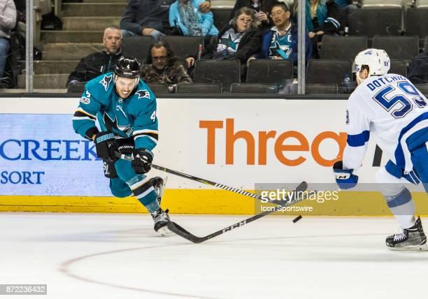 San Jose Sharks Defenceman Brenden Dillon gets the puck in the air past Tampa Bay Lightning Defenceman Jake Dotchin during the regular season match...